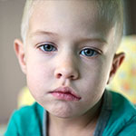 Артемий Верес, врожденный полный паралич лицевого нерва слева, спасет серия операций, 748650 руб.